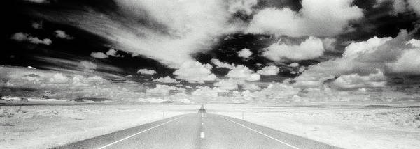 Wall Art - Photograph - Road In Arid Landscape Beneath Cloudy by Brian Bailey