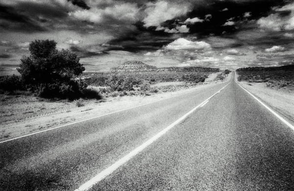 New Mexico Photograph - Road Running Through Desert, Hills And by Dennis O'clair