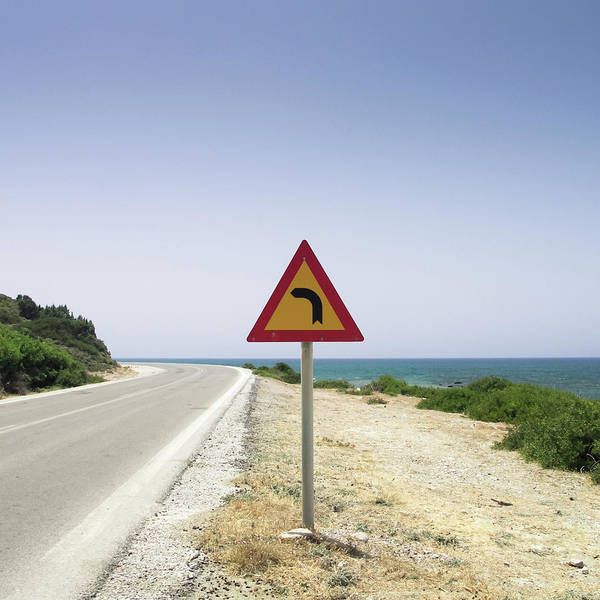 Dodecanese Photograph - Road With Traffic Sign And Sea by Halfoto.hu