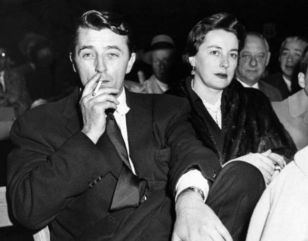 Stadium Photograph - Robert Mitchum And His Wife, Dorothy by New York Daily News Archive