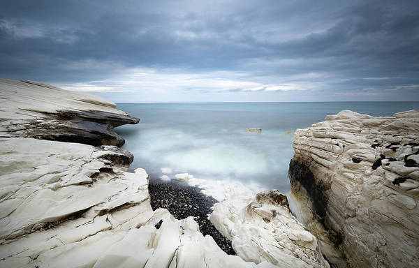 Photograph - Rocky Coast With White Limestones And Cloudy Sky by Michalakis Ppalis