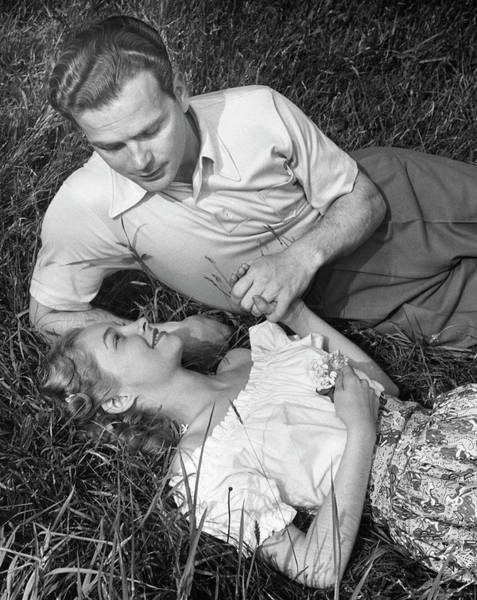 Heterosexual Couple Photograph - Romantic Couple In Meadow by George Marks