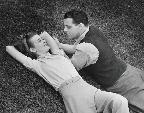 Romantic Couple Lying On Grass, B&w Art Print by George Marks