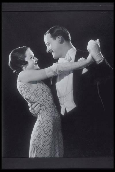 Evening Wear Photograph - Romantic Formal Couple Dances Slowly by Archive Holdings Inc.