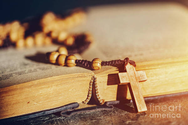 Photograph - Rosary With Cross Laying On A Bible Book. by Michal Bednarek