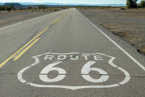 Painted Desert Photograph - Route 66 Shield Near Amboy Ca by Steve Gadomski
