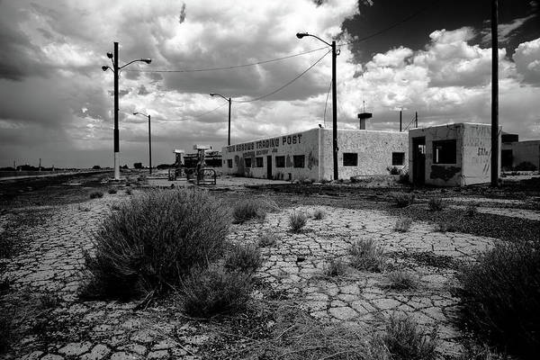 Photograph - Route 66 - Twin Arrows Trading Post 2012 Bw by Frank Romeo