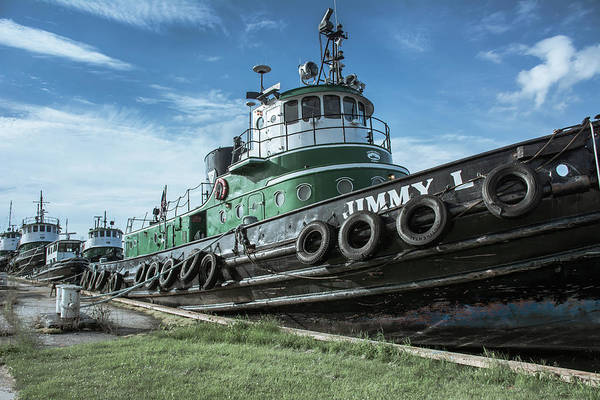 Wall Art - Photograph - Row Of Docked Tugs On Sturgeon Bay by John Bartelt