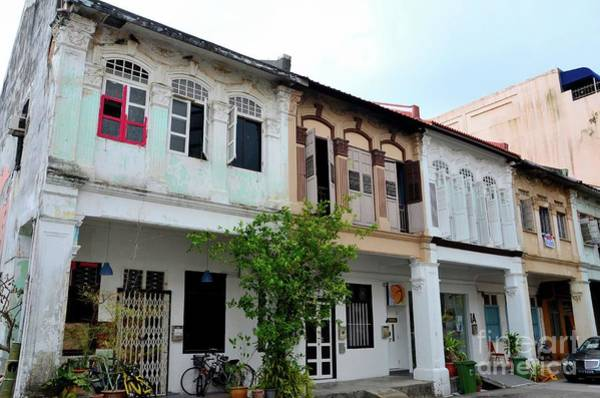 Photograph - Row Of Weathered Shophouses With Bicycles And Windows Kampong Glam Singapore by Imran Ahmed