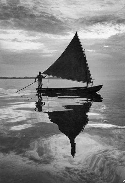 Rowboat Photograph - Rowboat With Sail Reflected In Calm by Eliot Elisofon