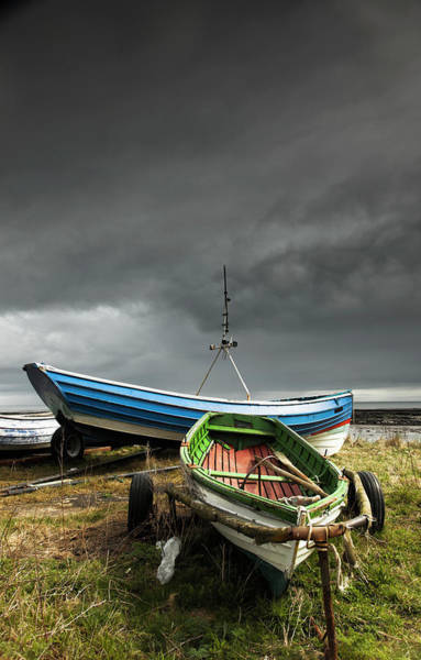 Rowboat Photograph - Rowboats Sitting On Trailers On The by John Short / Design Pics