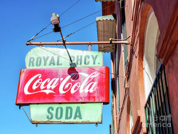 Photograph - Royal Pharmacy Sign In New Orleans by John Rizzuto