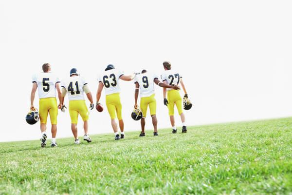 Football Helmet Photograph - Rugby Team Walking Together by Yuri Arcurs