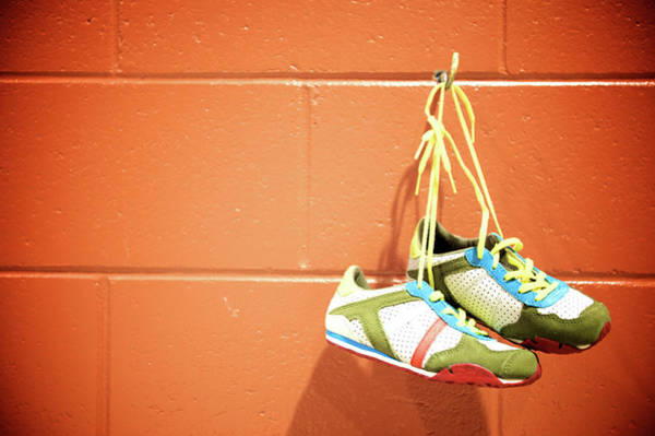 Hanging Photograph - Runnig Shoes Hanging On A Hook by Pascalgenest