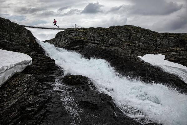 Wall Art - Photograph - Running Across A Bridge Above A by Per Breiehagen