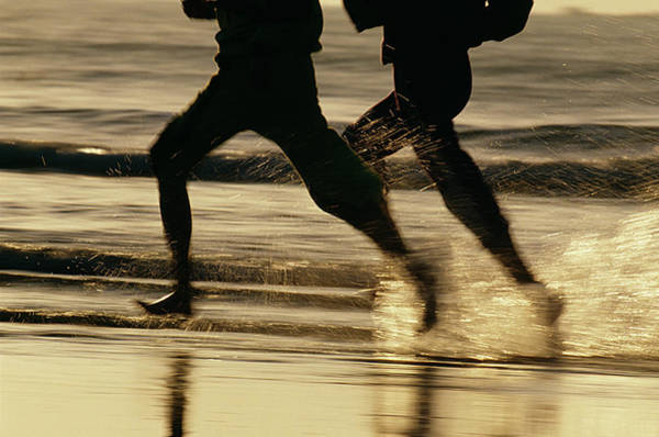 Heterosexual Couple Photograph - Running Couple At The Beach by Clu