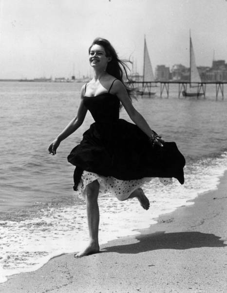 Cannes Photograph - Running Free by George W. Hales