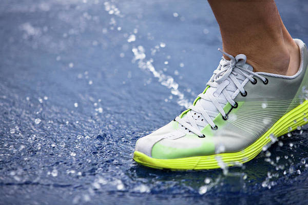 Shoe Photograph - Running Shoe Splashing Water On Track by Robin Skjoldborg