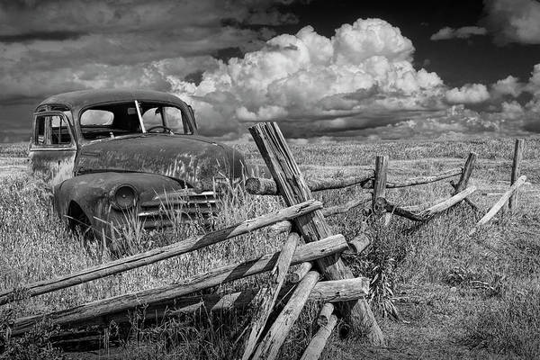 Photograph - Rural Landscape Rusted Vintage Automobile In Black And White by Randall Nyhof