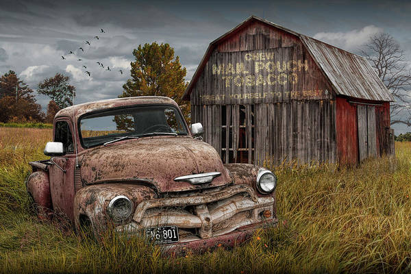 Photograph - Rusted Chevy Pickup Truck In A Rural Landscape By A Mail Pouch Tobacco Barn by Randall Nyhof