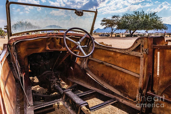 Photograph - Rusty Car Leftovers by Lyl Dil Creations