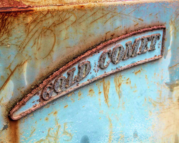 Photograph - Rusty Gold Comet Emblem by Kristia Adams