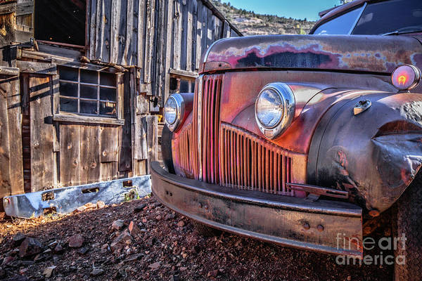Wall Art - Photograph - Rusty Old Truck In A Ghost Town In Arizona by Edward Fielding