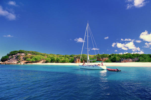St Martin Photograph - Sailboat Anchored And People On Beach by Don Hebert