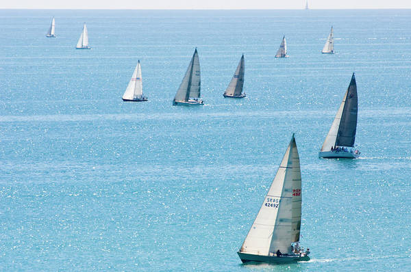 Sailboats Racing On Blue Water Art Print by By Ken Ilio