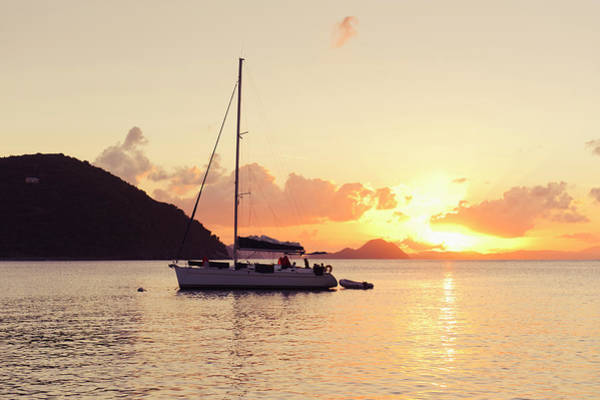 British Virgin Islands Photograph - Sailing Boat Against Sunset by Johner Images