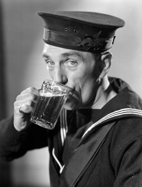 Drinking Glass Photograph - Sailor Drinking Beer by Fox Photos