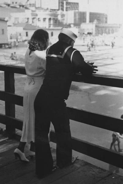 Usa Navy Photograph - Sailor On Shore Leave Standing On Pier W by Peter Stackpole