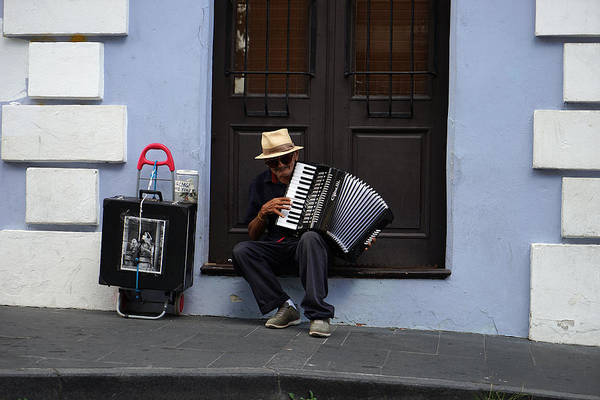 Photograph - San Juan Accordion Player - 5 Years On by Richard Reeve