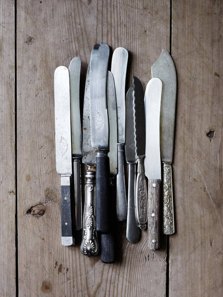 Setting Photograph - Scandinavia, Sweden, Knives On Wooden by Johner Images