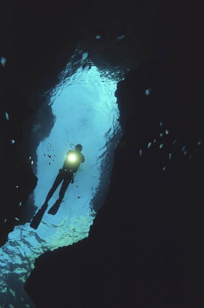 Scuba Diving Photograph - Scuba Diver Exploring Underwater Cave by Sami Sarkis