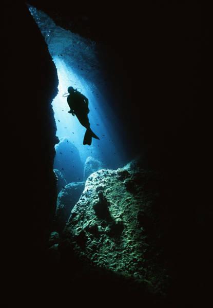 Scuba Diving Photograph - Scuba Diver Swimming Towards Cave Exit by Zac Macaulay