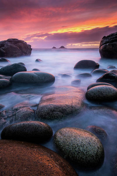 Wall Art - Photograph - Sea And Stones At Porth Nanven Beach, West Cornwall, Uk by Ross Hoddinott / Naturepl.com