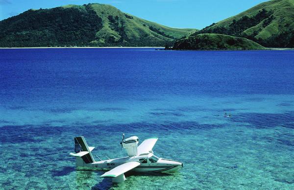 High Water Mark Photograph - Seaplane In Water Between Yasawa And by Mark Daffey