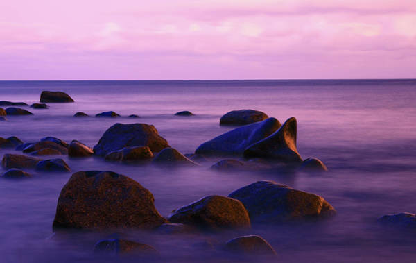 Waters Edge Wall Art - Photograph - Seascape With Some Rocks Protruding The by Imaginegolf