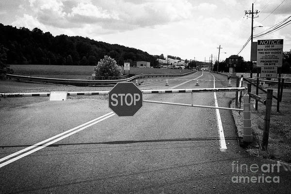 Wall Art - Photograph - security barrier at the entrance to the Y-12 complex in the former secret city of Oak Ridge Tennesse by Joe Fox