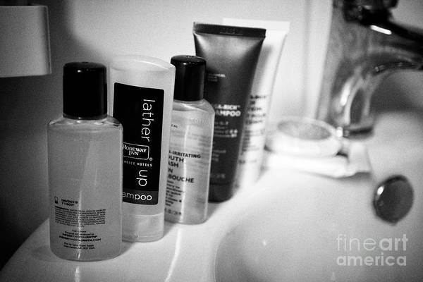 Wall Art - Photograph - Selection Of Mini Bottles Of Collected Toiletries Including Shower Gels And Soaps From Various Hotel by Joe Fox