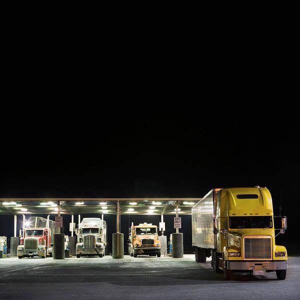 Wall Art - Photograph - Semi-trucks At Truck Stop Gas Pumps by Jamie Kripke
