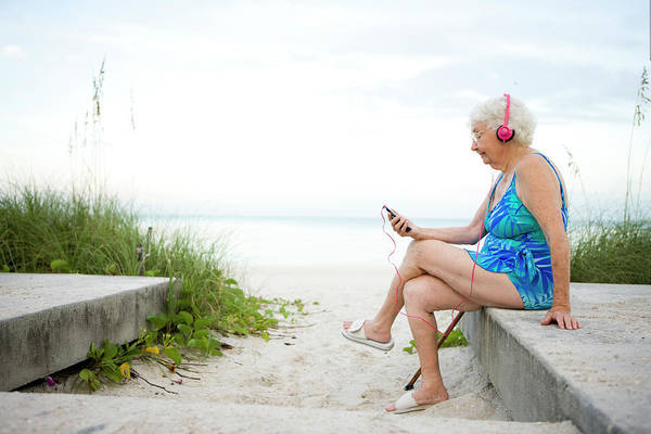 Gray Hair Photograph - Senioir Woman Listening To An Mp3 by Marcy Maloy