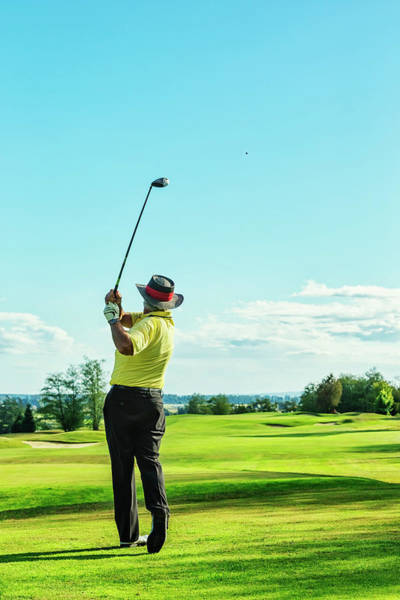 Golf Photograph - Senior Golfer On Golf Course Teeing Off by Jhorrocks