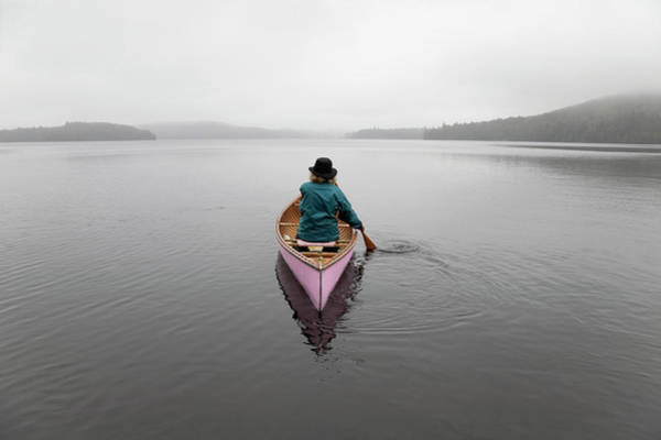 Senior Photograph - Senior Woman Canoeing Solo On A Misty by Mary Ellen Mcquay