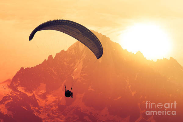 Courage Wall Art - Photograph - Sepia Paraglide Silhouette Over Alps by Pavel Burchenko