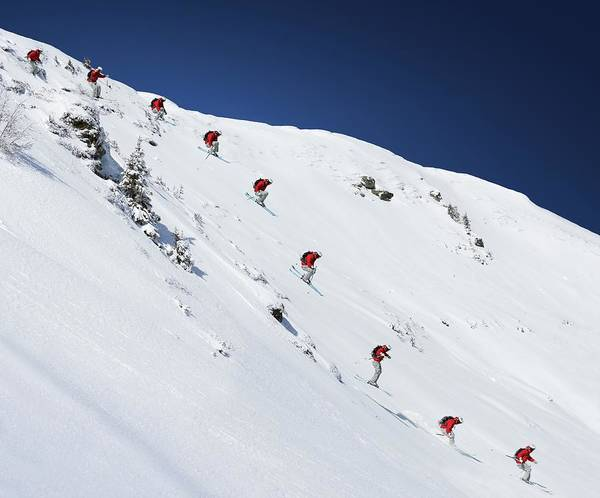 Alpine Skiing Photograph - Sequence Of Male Skier Jumping Down by Adie Bush