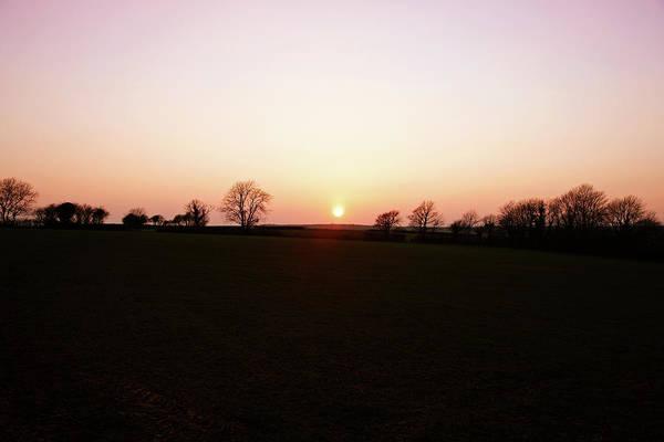 Setting Photograph - Setting Sun Behind Hillside Tree Line by Tirc83