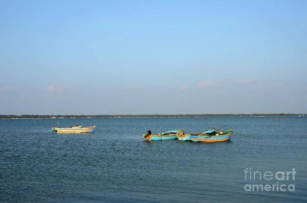Photograph - Several Blue And Yellow Boats Moored Anchored In Waters Of Jaffna Sri Lanka by Imran Ahmed