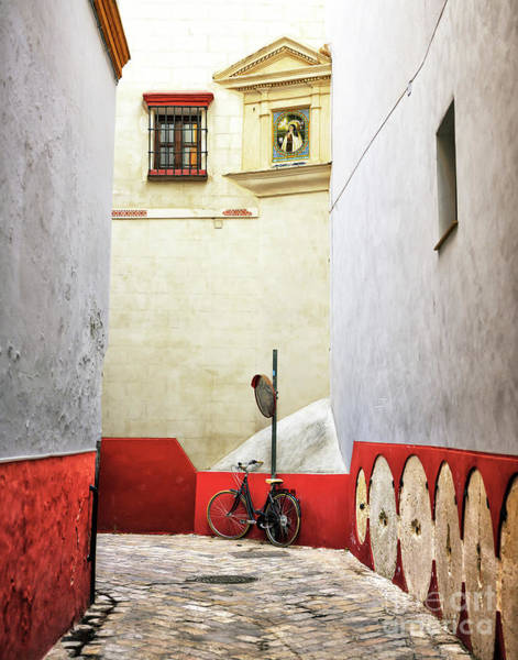 Photograph - Seville Bike In The Alley by John Rizzuto